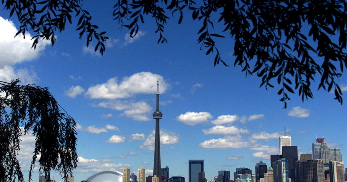 The CN Tower and the Skydome highlight the Toronto skyline.</p>