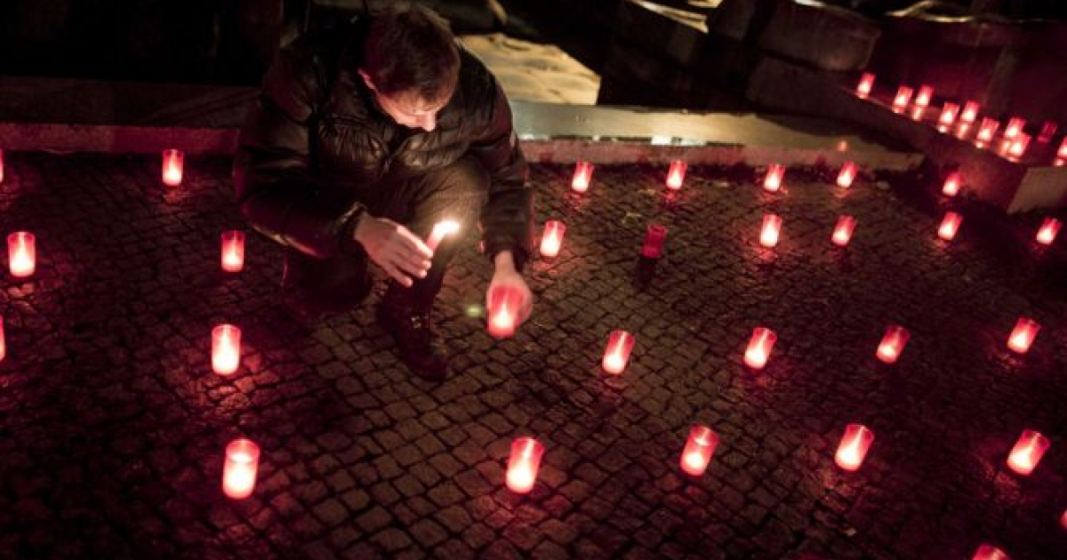 A member of the Berlin gay community lights candles after a march to mark World AIDS Day on November 30, 2012 in Berlin, Germany. Cities across the world are marking World AIDS Day, which officially takes place on December 1, with a variety of events.</p>