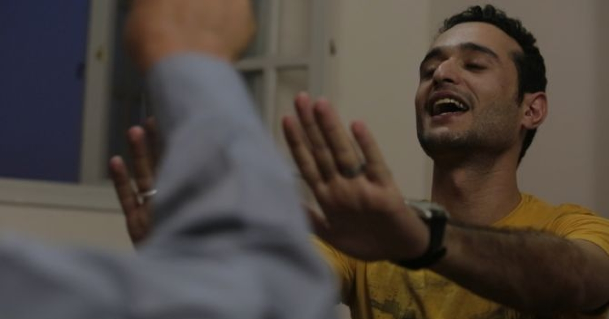 Ahmed Douma, 24, a secular, pro-democracy activist, argues with his father, Saad Douma, 55, a lifelong member of the Muslim Brotherhood, before breaking the fast on the first Friday night of the Muslim holy month of Ramadan on  July 12, 2013.</p>