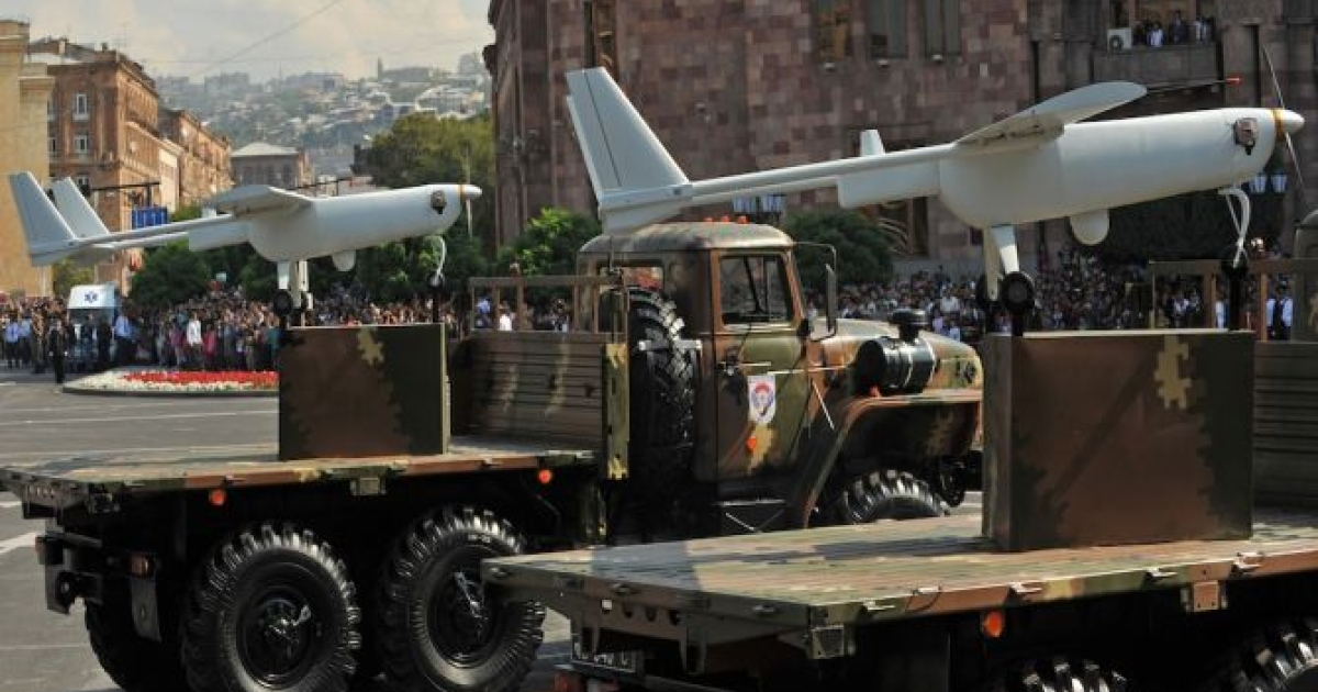 Armenian-built drones atop their launchers roll during a military parade in 2011. Armenia and Azerbaijan are both flexing their military muscles, flying drones over the border between them and fueling worries that the exercises could lead to all-out war.</p>