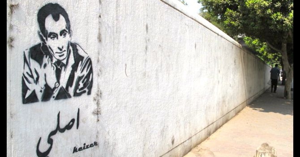 </p> Well-known for his bold, hard-hitting journalism, Yosri Fouda's graffitied face appears all over Cairo, reading