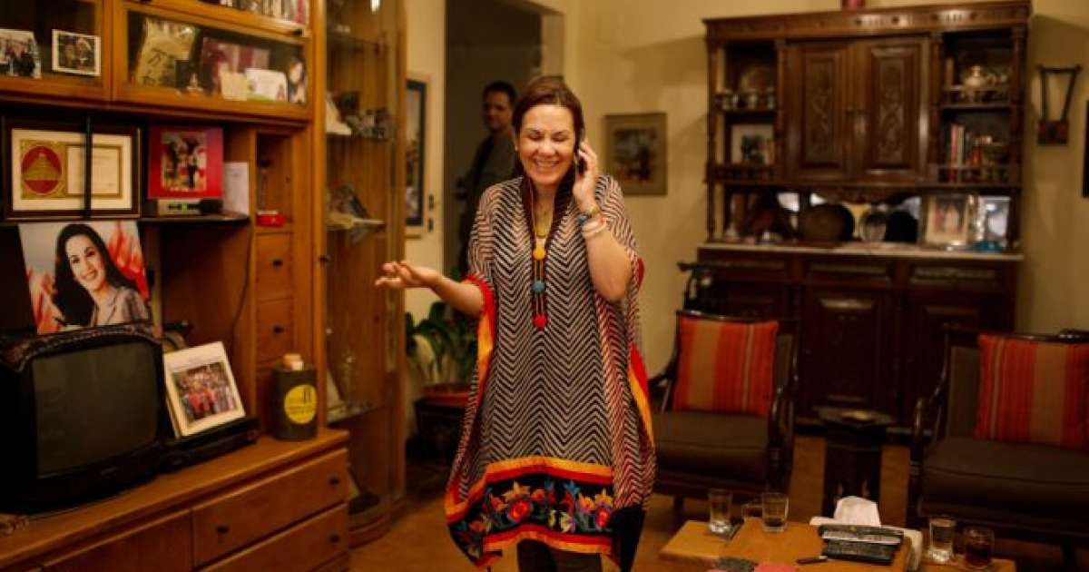 Bothaina Kamel speaks on her phone at her home in downtown Cairo before leaving in for TEDx Tanta, an ideas-oriented gathering held on May 19, 2012. </p>