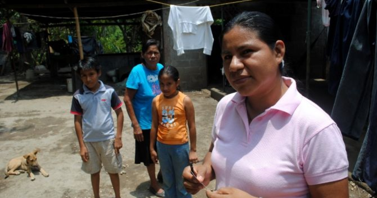 Martha Acuña at home in Masaya, Nicaragua with her mother and two children. Her husband's death in a motorcycle accident left her as the only wage-earner in the eight-member household. </p>