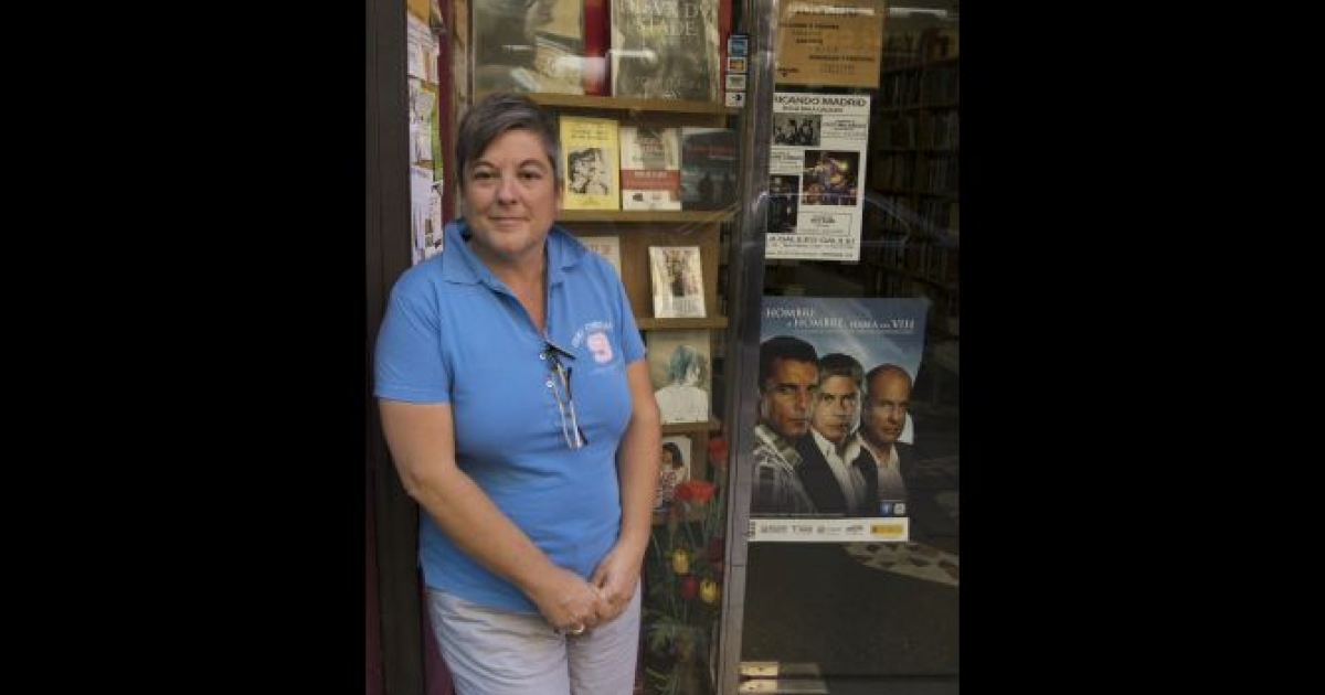 Mili Hernandez outside her bookshop Berkana, Spain's first gay and lesbian bookshop, in the Chueca district of Madrid, 2011.</p>