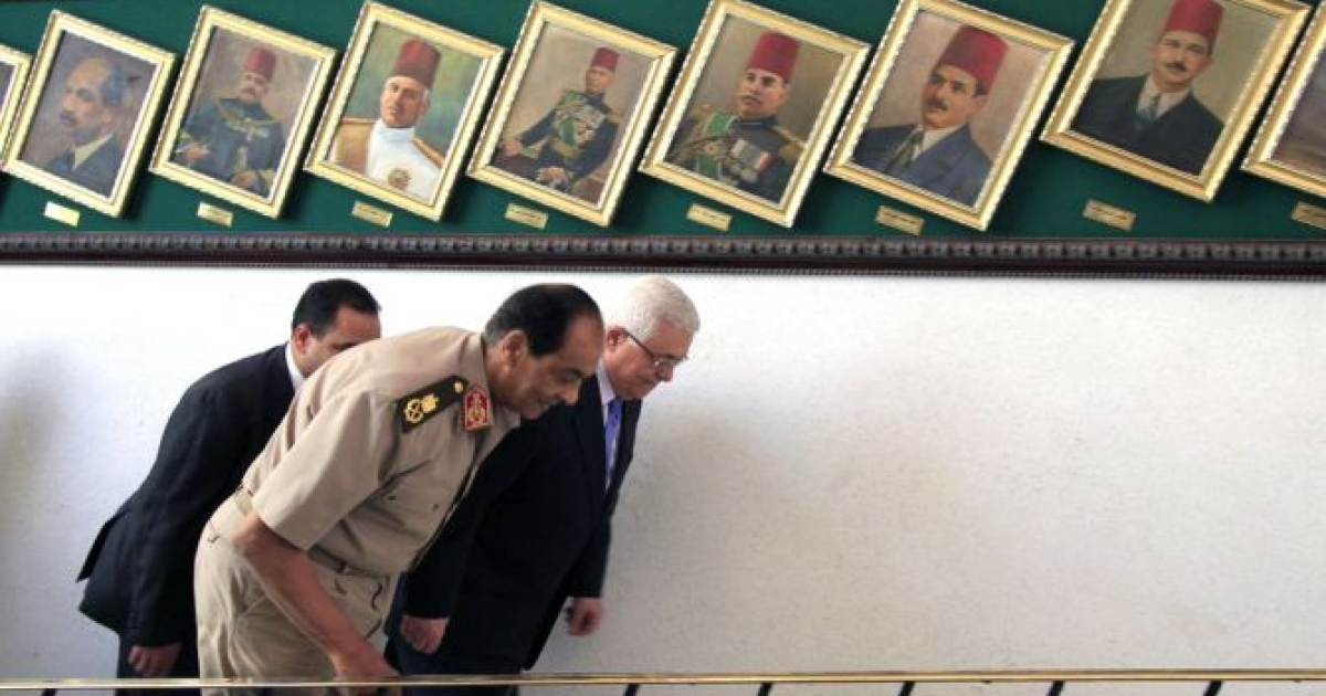 Palestinian president Mahmud Abbas (R) walks next to Field Marshal Hussein Tantawi, head of the ruling Supreme Council of the Armed Forces, prior to their meeting at the Ministry of Defense headquarters in Cairo on May 30, 2011.</p>