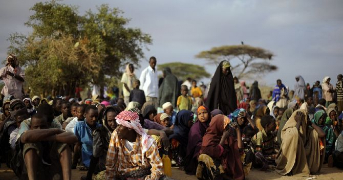 Somali refugees line up at a registration center in one of northern Kenya's refugee camps to receive aid after having been displaced from their homes by a famine that is ravaging the horn of Africa region. Ugandans like Alex and Michael make up a small fraction of the hundreds of thousands of refugees in the camps.</p>