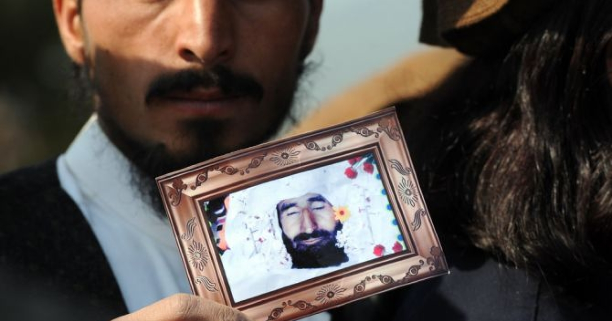 A Pakistani tribesman shows a photograph of a US drone attack victim during a protest in Islamabad on February 25, 2012, against the US drone attacks in the Pakistani tribal region. The protesters demanded an immediate end to drone attacks and compensation for those who lost relatives or property.</p>