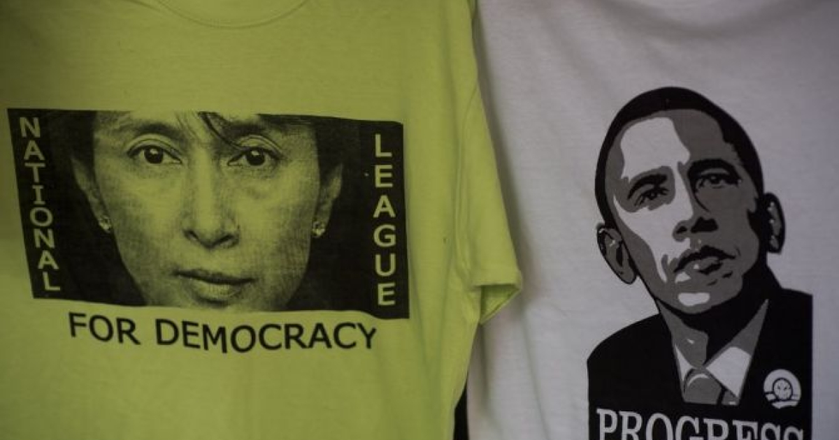 T-shirts of Myanmar pro-democracy leader Aung San Suu Kyi (L) and US President Barack Obama (R) are displayed for sale at a market in Yangon on November 18, 2012.</p>