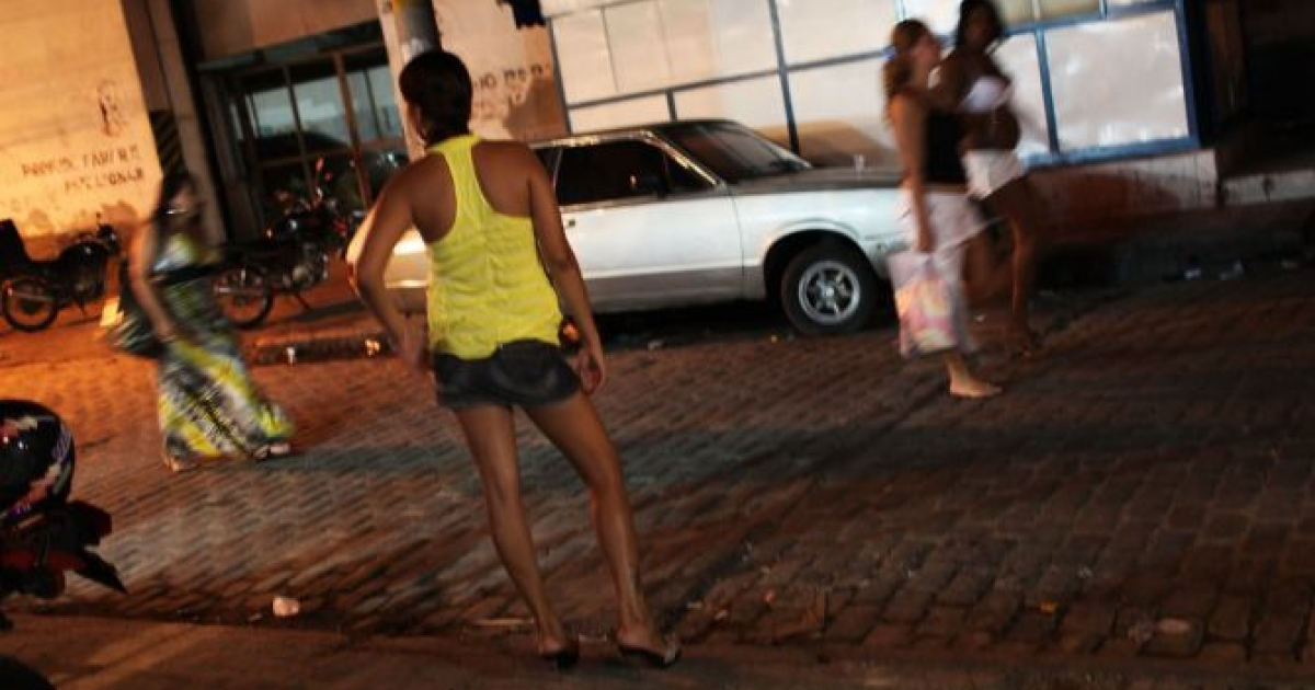 Female prostitutes walk the streets of the red light district, Vila Mimosa, following a fashion show with clothes designed by sex workers on December 11, 2009 in Rio de Janeiro, Brazil. </p>