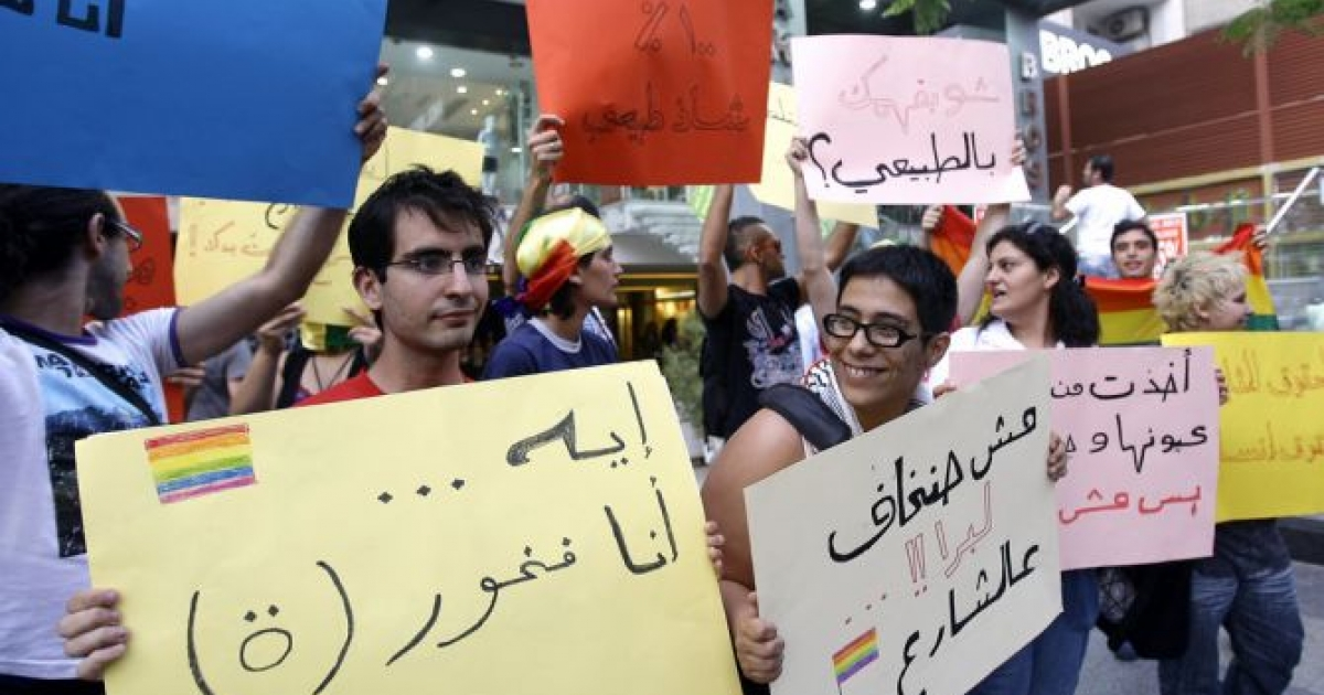 Lebanese protesters hold signs in support of homosexual people and against their discrimination during a demonstration on the eve of the International Day Against Homophobia in Beirut on May 16, 2010.</p>