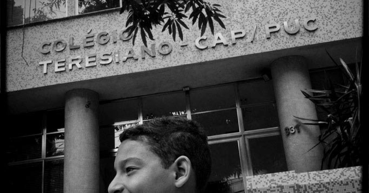 Lucas Cherpe de Abreu, 11, in front of his school, Colegio Teresiano, an upper class private school. Lucas is able to study at Teresiano thanks to his father, Adilson Mendes Junior, 34, a school employee.</p>