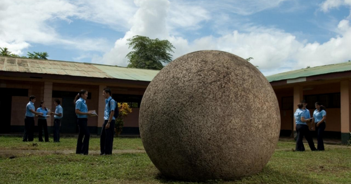Almost perfectly round stone spheres, such as this one at a school in Palmar Norte, dot the Southern Zone of Costa Rica.</p>