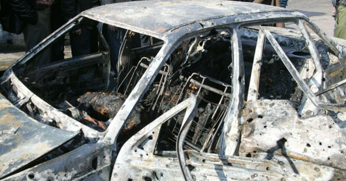 An image published by state news agency SANA shows one of the two cars reportedly packed with explosives and set off outside government buildings in Damascus, Dec. 23, 2011.</p>