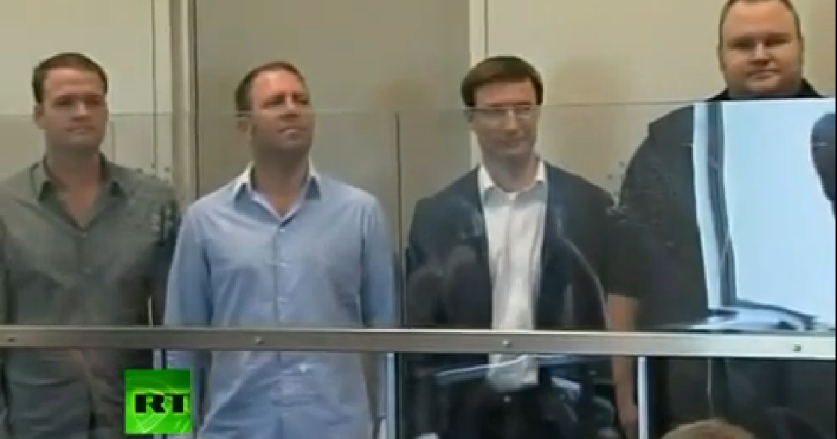 Kim Dotcom, right, appears in court with his three co-accused, in Auckland, New Zealand, Jan. 20 2012.</p>