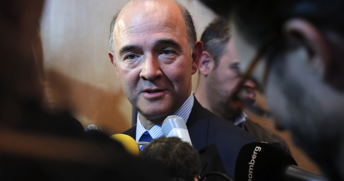 France's Economy minister Pierre Moscovici answers journalists' questions after a press conference, on Nov. 20, 2012 at the ministry in Paris, one day after the international ratings agency Moody's cut the French government bond rating by one notch from the highest level to 'Aa1.' An additional downgrade is possible.</p>