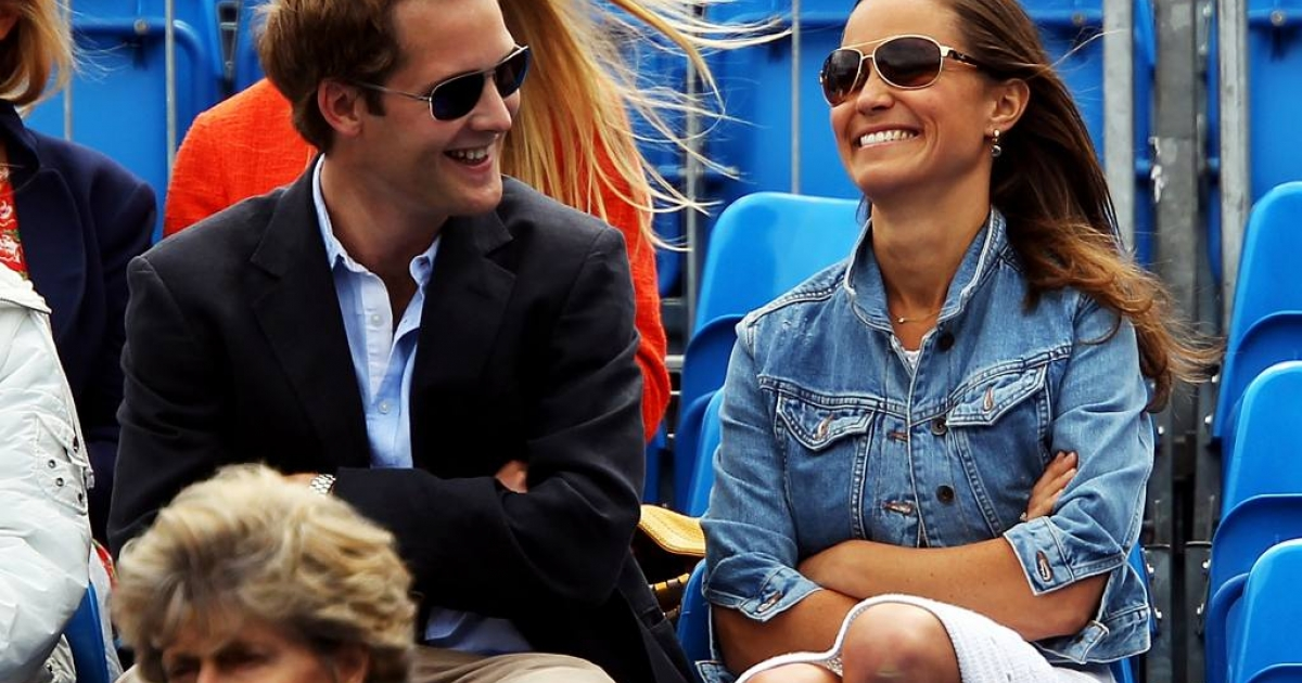 Pippa Middleton, wearing a casual denim jacket over a white knit dress, laughed with a friend at the AEGON Championships at Queens Club.  They attended the Men's Singles third round match on June 9, 2011 between American Andy Roddick and South African Kevin Anderson.</p>