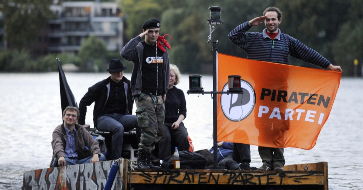 Members of the German Pirate Party sail on the River Spree during a