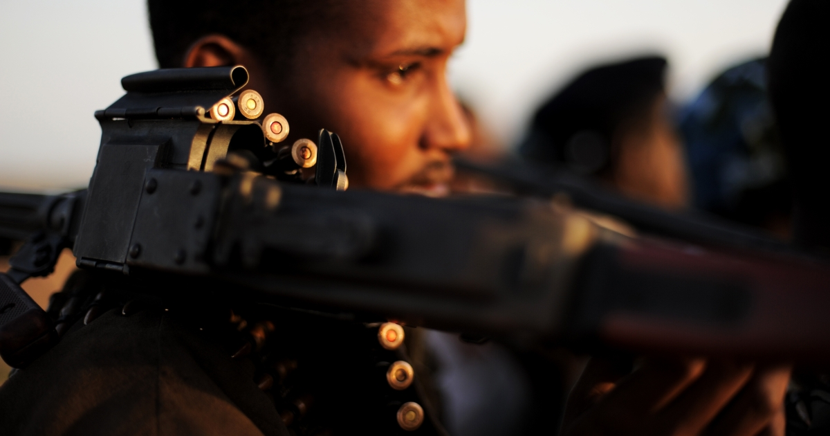 An armed fighter allied to the Somalia's Hobyo pirates holds his high caliber weapon near the central Somali town of Galkayo on Aug. 18, 2010. Hobyo pirates have collected millions of dollars in ransoms over the past two years. They even have currency checking and counting machines for the bags of air-dropped cash they receive.</p>