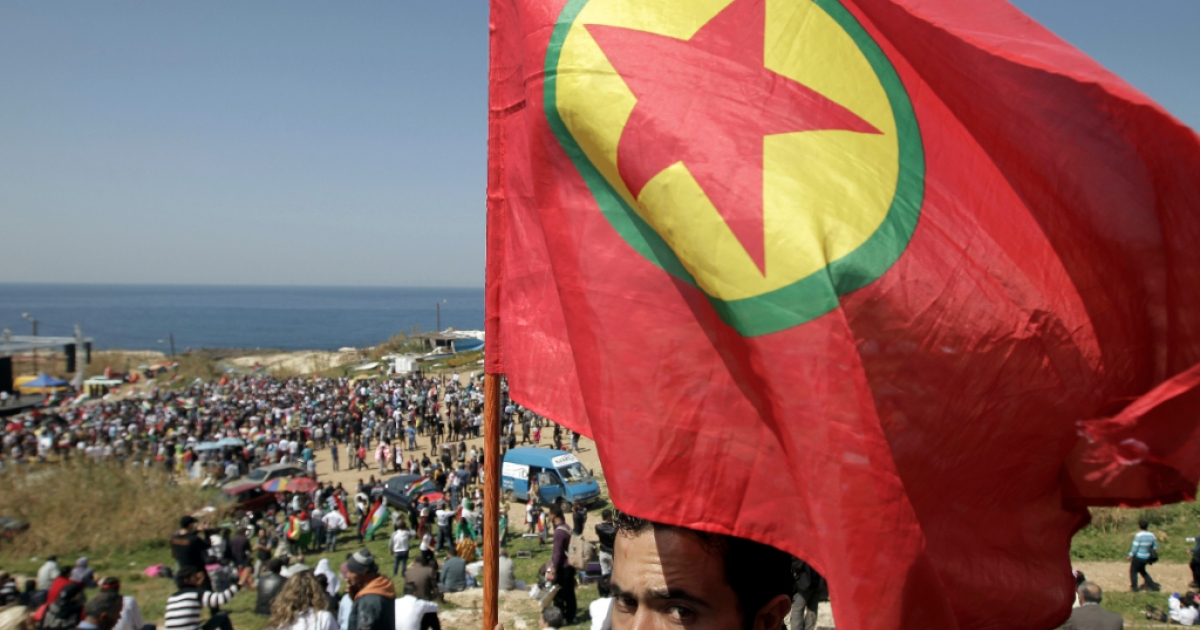 A Kurdish man holds up a flag of the Kurdistan Workers Party (PKK) during Noruz spring festival in the Lebanese capital Beirut on March 21, 2012.</p>