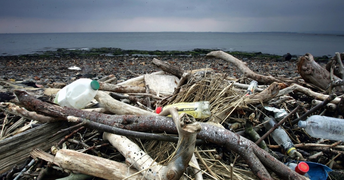 Tires, plastic bottles and other garbage washed up by the sea litters the beaches in Prestwick, Scotland, on 22 Mar. 2005.</p>