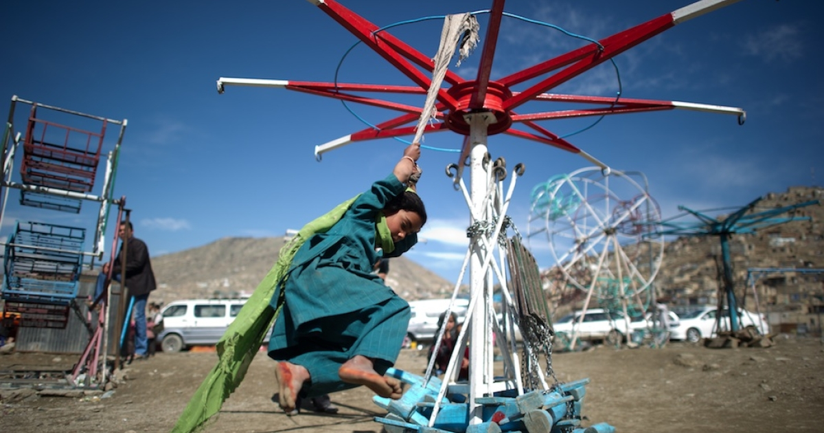 A young Afghan girl plays on swings near the Kart-e-sakhi shrine in Kabul on April 10, 2012.</p>