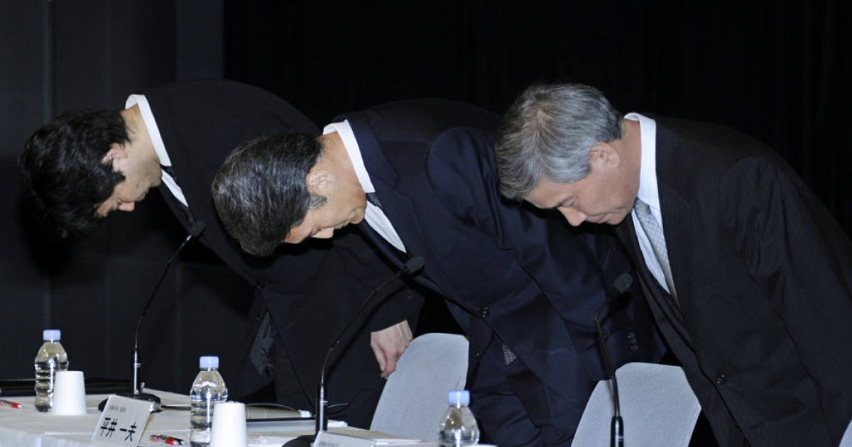 Sony's executive vice president, Kazuo Hirai (center) and company executives Shiro Kambe (left), and Shinji Hasejima (right), bow in apology for the theft of personal data from the Playstation Network.</p>