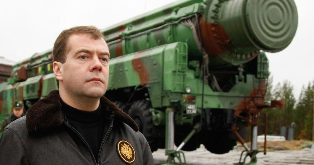 Russian President Dmitry Medvedev surveys a RS-12M Topol ballistic missile at the Plesetsk launch base on October 12, 2008.</p>