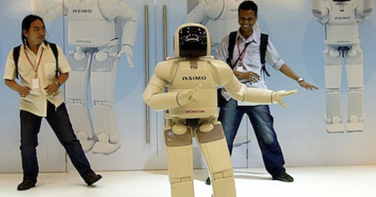 A humanoid robot, ASIMO, performs the