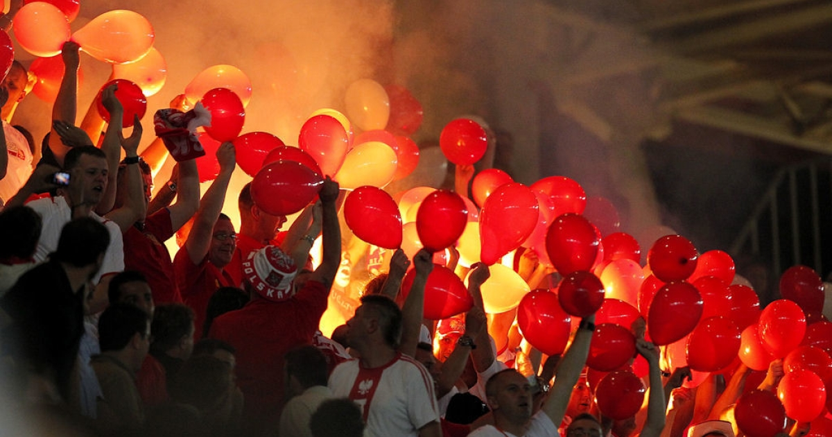 Polish supporters light flares during a friendly football match between Spain and Poland at the Nueva Condomina stadium in Murcia, Spain on June 8, 2010.</p>