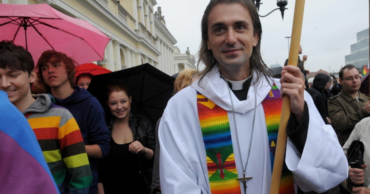 A man dressed as a priest participates in the gay pride parade in Warsaw on June 13, 2009.</p>