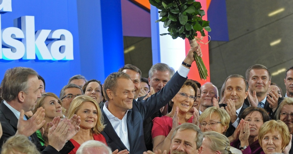 Polish Prime Minister Donald Tusk (C) reacts after the announcement of exit poll results of the parliamentary elections on October 9, 2011, in Warsaw.</p>