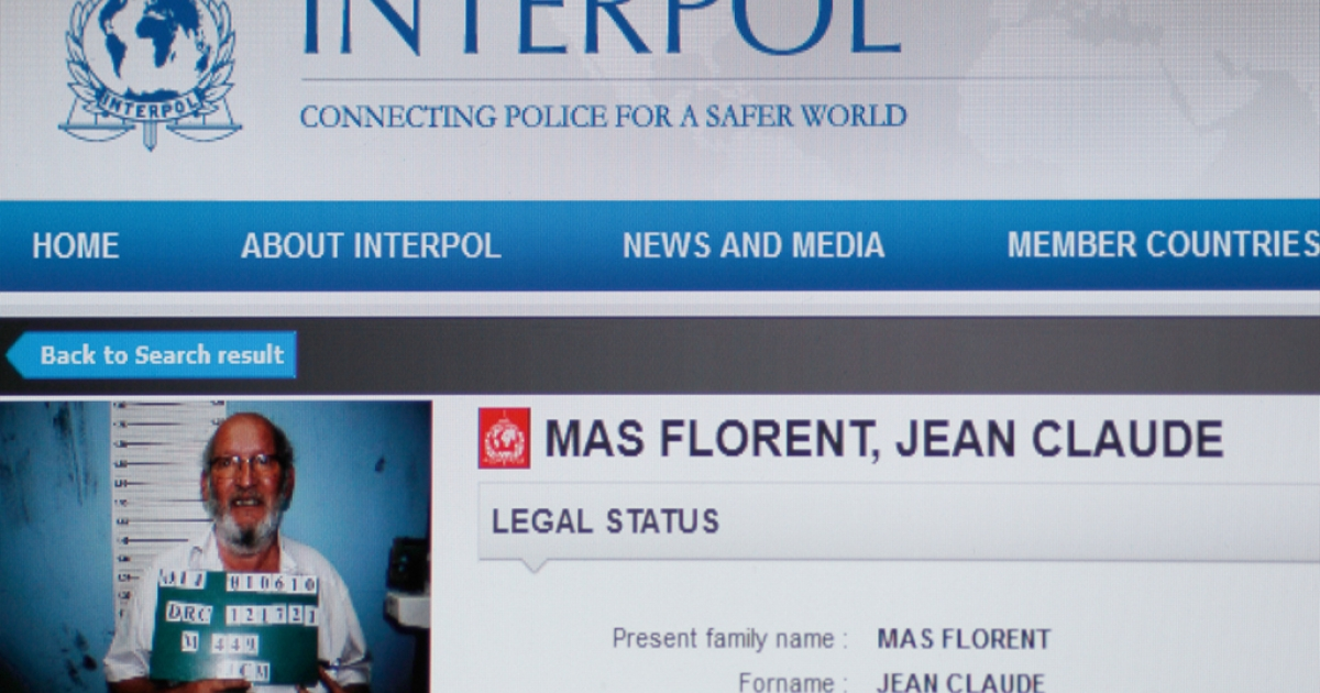 A photo of a computer screen taken on December 24, 2011 in Paris, shows the Interpol's website with French Jean-Claude Mas, CEO and founder of the French Poly Implant Prothese (PIP) company, who is wanted by Costa Rican authorities for crimes involving 'life and health'.</p>