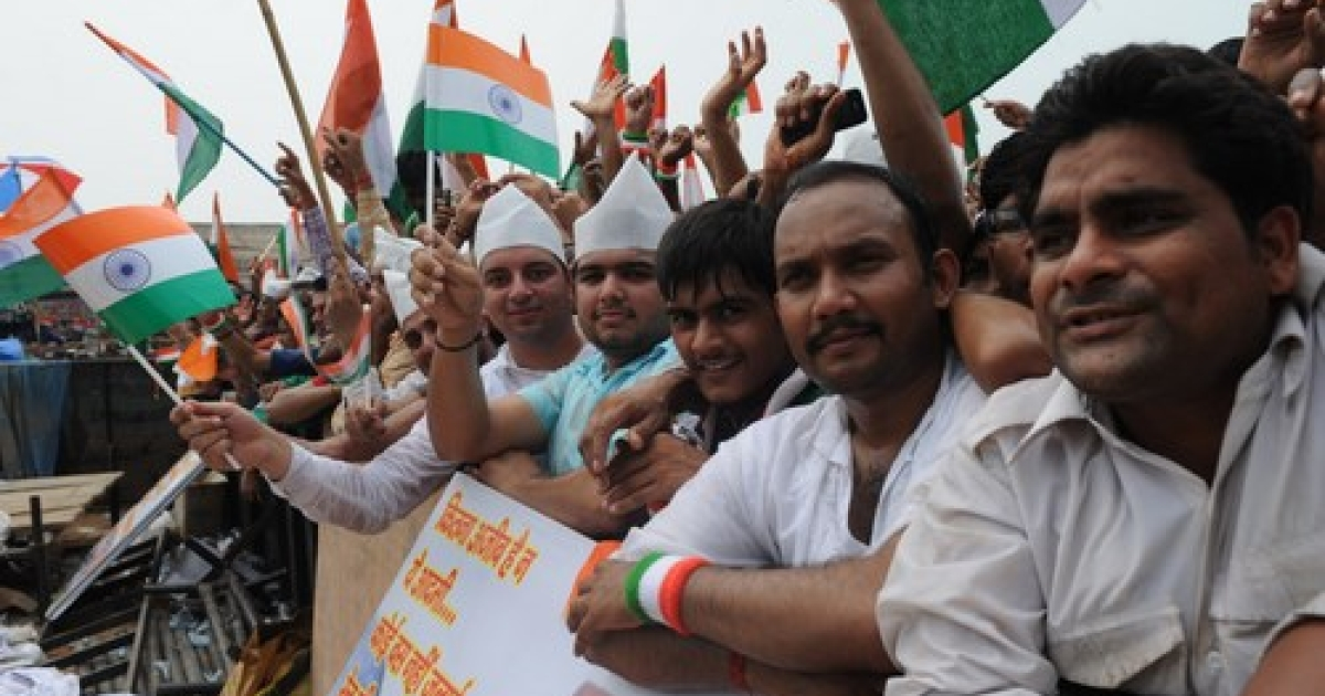 Supporters of anti-corruption activist Anna Hazare wave Indian national flags during Hazare's fast at Ramlila Grounds in New Delhi on August 22, 2011. Responding to anti-corruption crusader Anna Hazare's call, supporters begun sit-in protest outside residences of their respective MPs across the country.</p>