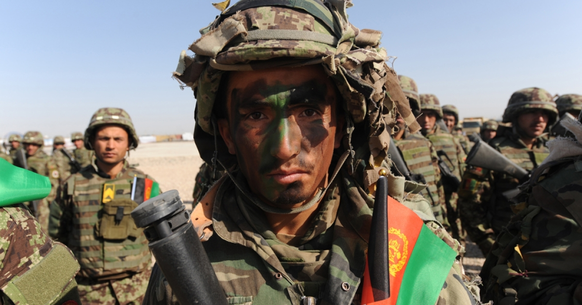 An Afghan National Army (ANA) looks on during a ceremony at Camp Shaheen in Dehdady district near Mazar-i Sharif on March 26, 2012. The latest poll from New York Times/CBS News found that 69 percent of Americans want US troops out of Afghanistan.</p>