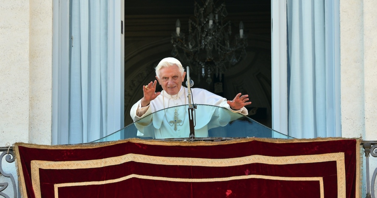 Pope Benedict XVI waves a the balcony upon his arrival at his residence of Castel Gandolfo on June 3, 2012.</p>