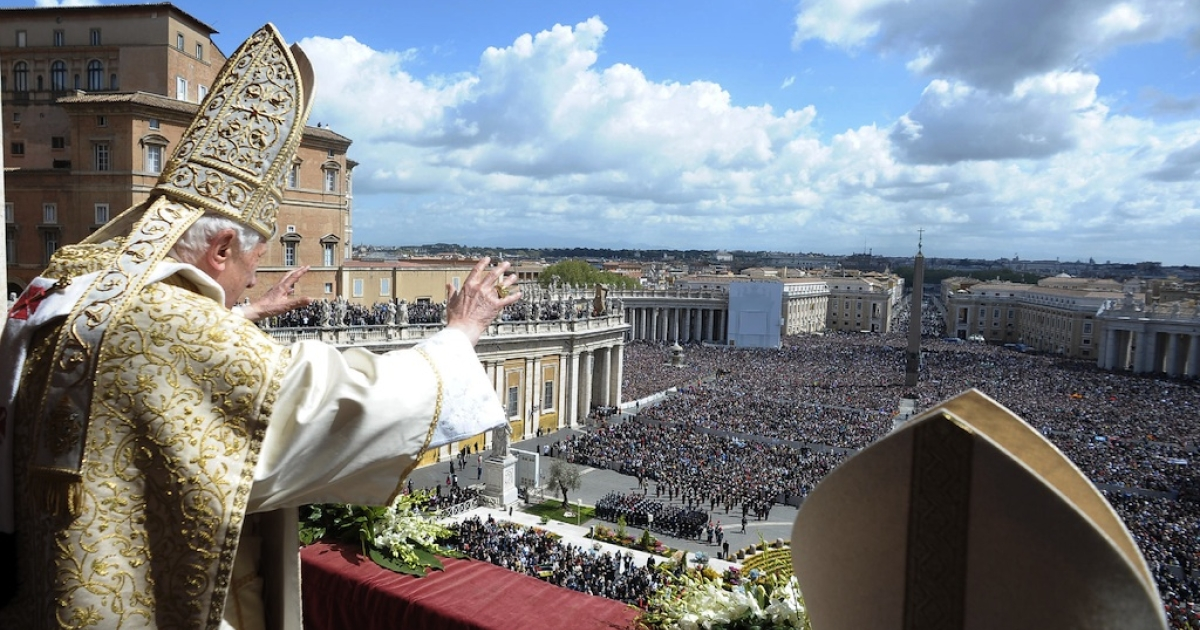 Pope Benedict XVI delivers his 'Urbi et Orbi' message and blessing from the central balcony of St. Peter's Basilica at the end of the Easter Mass on April 8, 2012 in Vatican City, Vatican.</p>