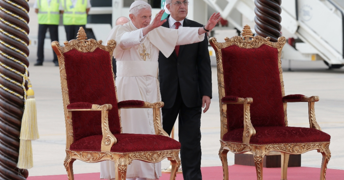 Pope Benedict XVI stands next to Lebanese President Michel Sleiman as he waves to the crowds upon his arrival at Beirut's Rafiq Hariri International Airport on September 14, 2012. Pope Benedict XVI arrived in Lebanon on Friday bringing a clear message on the conflict in neighbouring Syria, calling for an end to arms imports.</p>