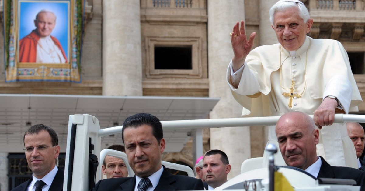 Pope Benedict XVI waves as he stands with butler Paolo Gabriele, center, on May 4, 2011, at St Peter's square at The Vatican.</p>