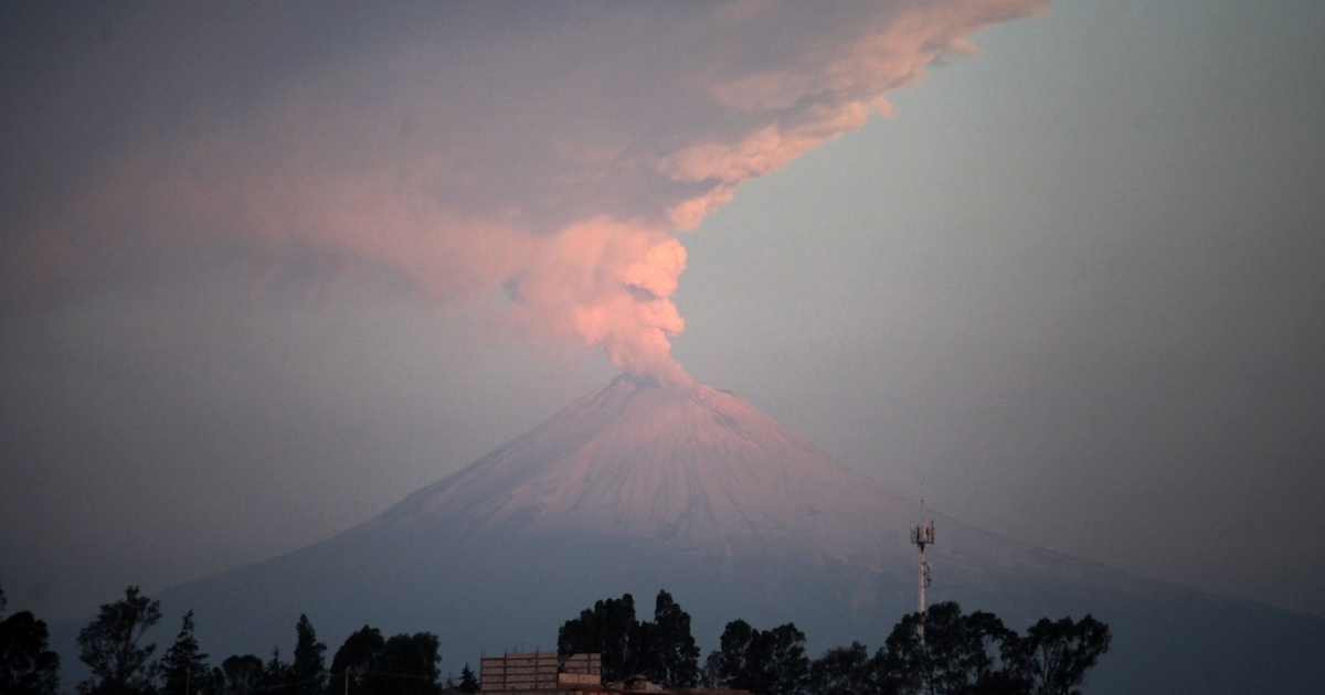 Popocatepetl volcano spews ash and smoke into the air on Wednesday.</p>