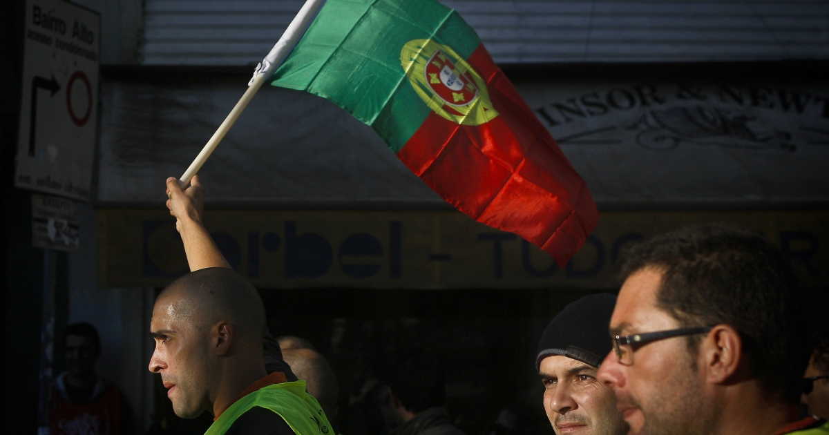 Portuguese workers protest during government austerity measures.</p>