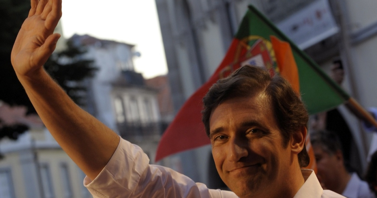 The leader of the center-right Social Democratic Party Pedro Passos Coelho greets supporters on June 3, 2011, in Lisbon, ahead of the June 5 elections.</p>