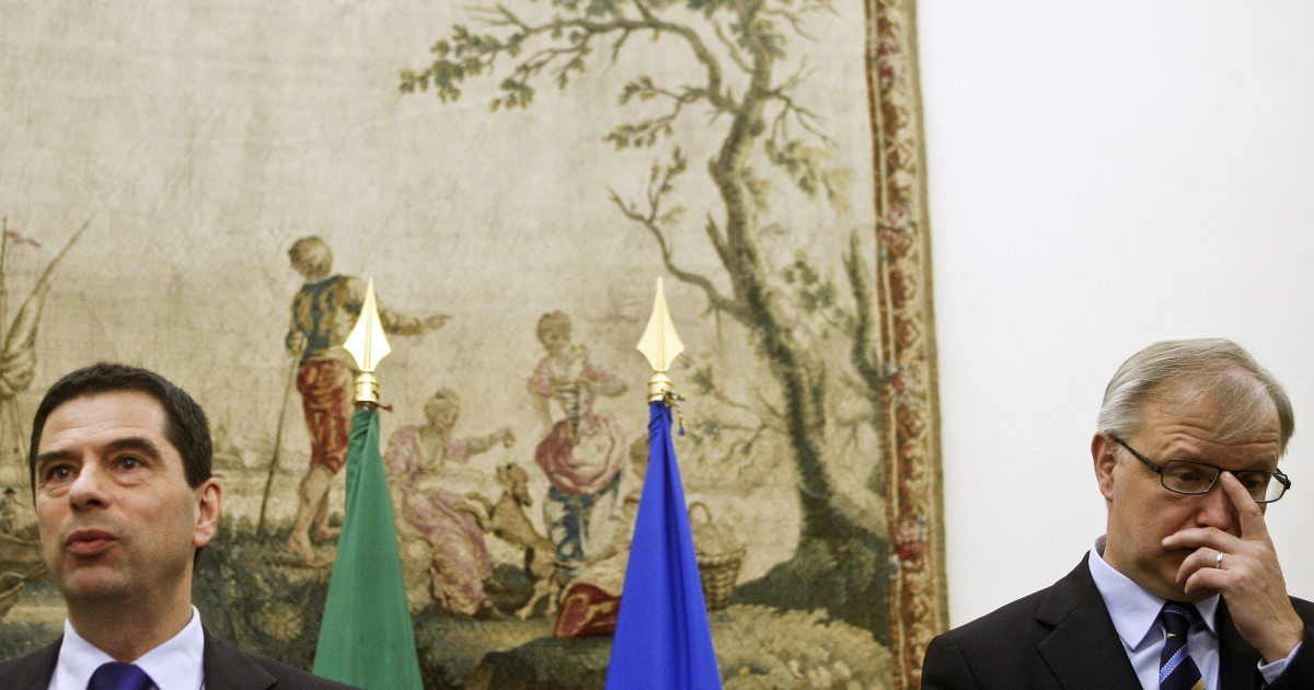 European Commissioner for Economic and Financial Affairs Olli Rehn (R) attends a press conference accompanied by the Portuguese finance minister, Vitor Gaspar (L) at S. Bento Palace, in Lisbon, on March 14, 2012.  Portugal is swallowing the EU's austerity medicine in return for loans.  It seems that medicine is not helping individual patients using the country's health system.</p>