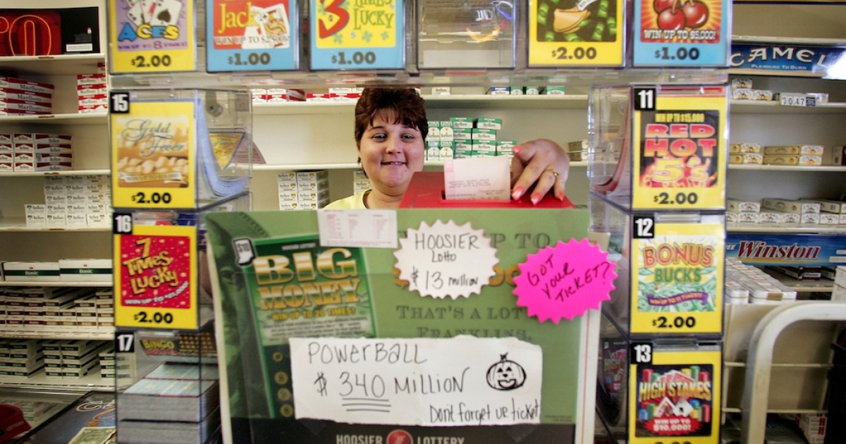 Maryanne Rearick rings up Powerball lottery tickets for customers at a cigarette store in Whiting, Indiana.</p>