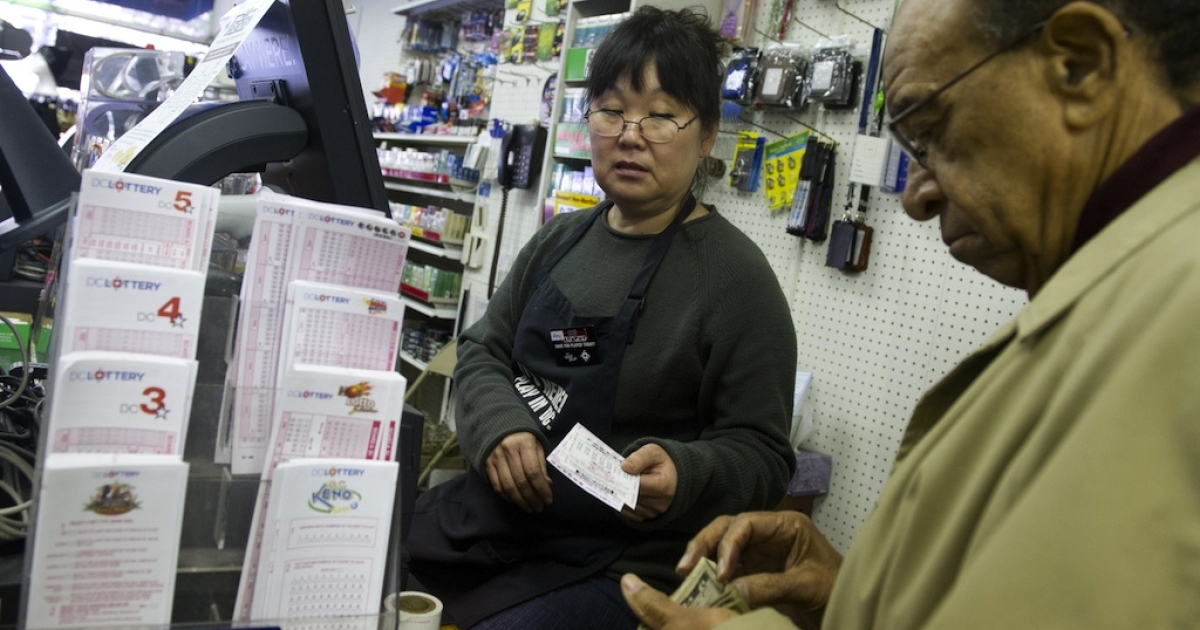 Morris James of Washington, DC, buys Powerball tickets for Wednesday's draw.</p>