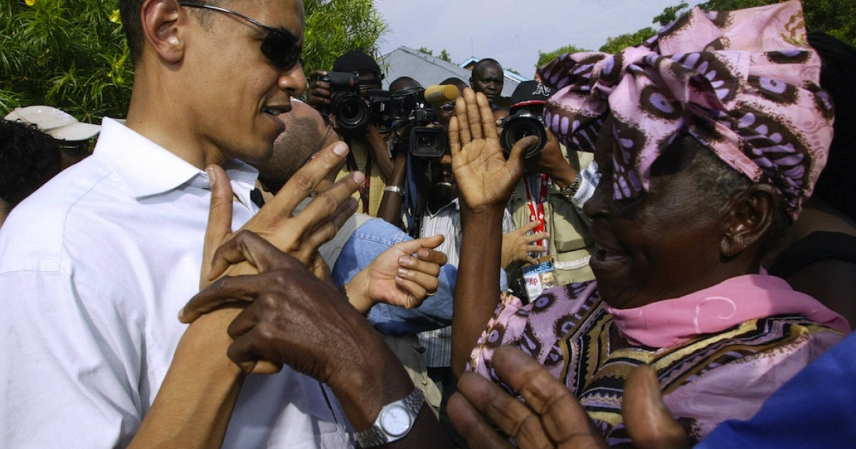 Then-US Senator Barack Obama greets his grandmother Sarah Obama at their rural home in Siaya, Kisumu, on Aug. 26, 2006 during his first visit in 14 years.</p>