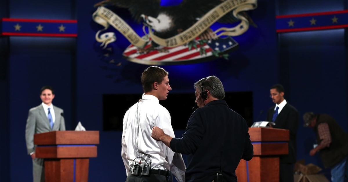 University of Denver students stand in for US President Barack Obama, Republican Presidential candidate Mitt Romney and moderator Jim Lehrer during a dress rehearsal for Wednesday's presidential debate at Denver University on Oct. 2, 2012.</p>