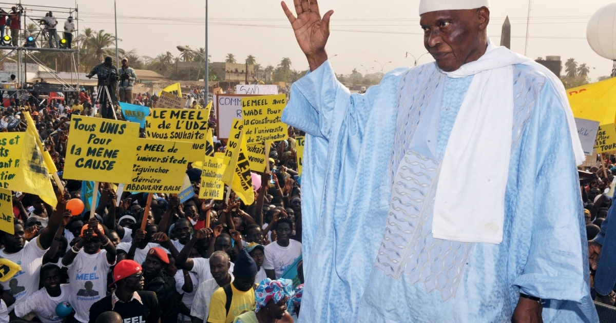 Senegal's President Abdoulaye Wade (R) waves to his supporters during a rally in the capital of the Casamance region Ziguinchor on February 11, 2012, ahead of February 26 presidential election.</p>