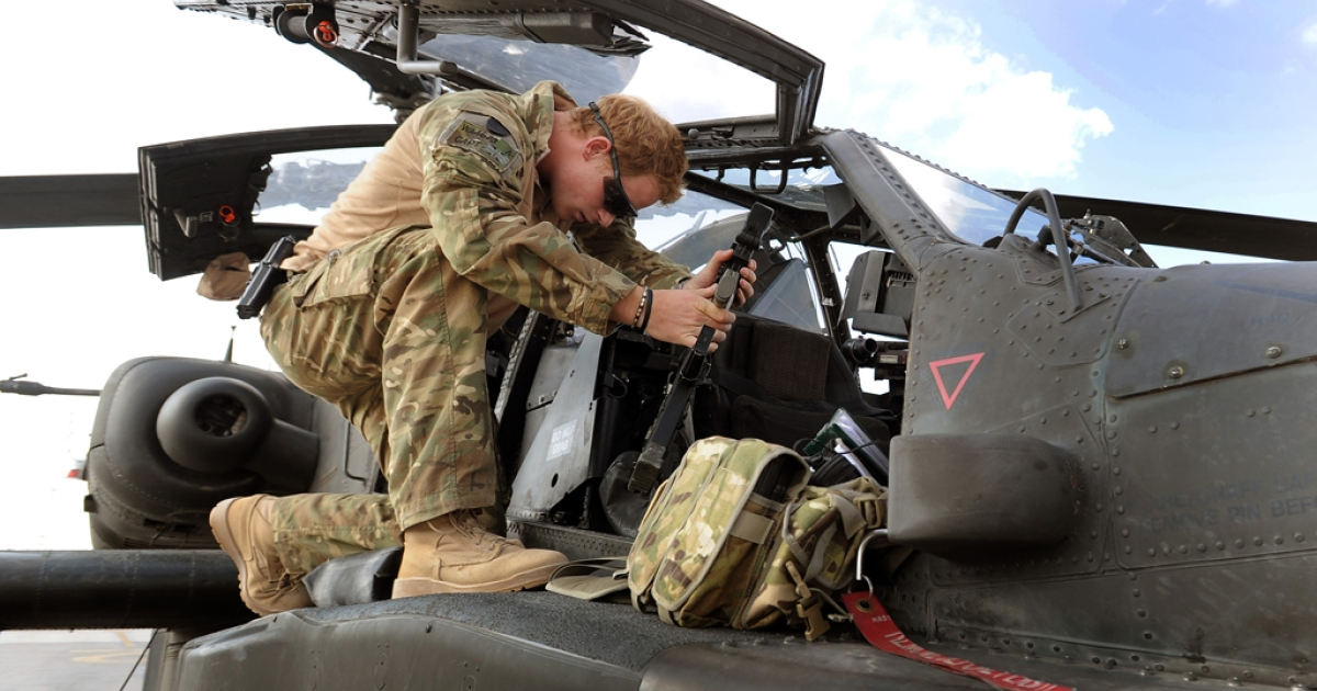 In this image released on Jan. 21, 2013, Prince Harry works on an Apache Helicopter at the British-controlled Camp Bastion in southern Afghanistan. Harry served as a pilot/gunner for four months with the 662 Squadron of the Army Air Corps, from September 2012 until January 2013.</p>