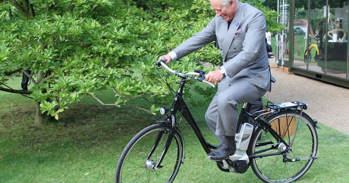 Prince Charles, Prince of Wales rides an eco-bike as he attends The Earth Awards Exhibition at Clarence House in London, England. Charles is an avid environmentalist.</p>