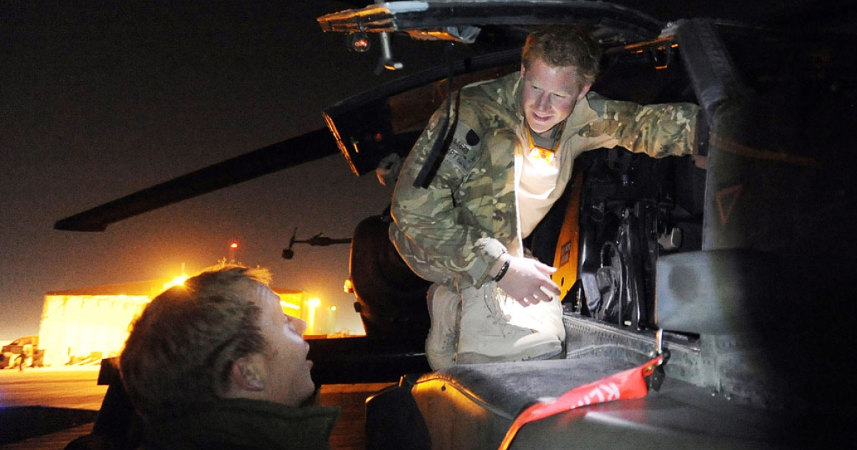 Prince Harry, an army captain, inspects his Apache helicopter on January 21, 2013, before a night mission from Camp Bastion on December 10, 2012 in Afghanistan.</p>